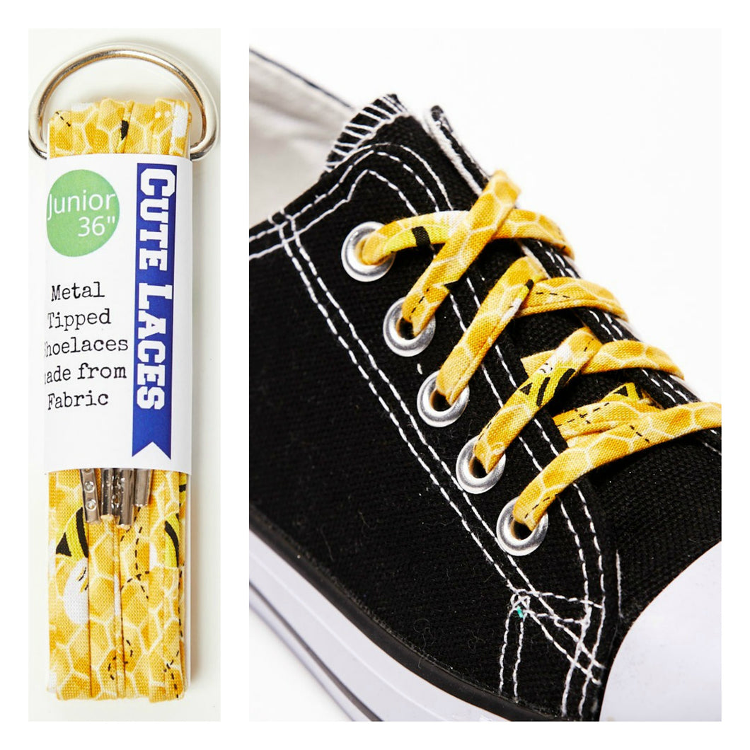0232576b1aa9 ... honeycomb shoe laces  yellow shoelaces on a black converse shoe ...
