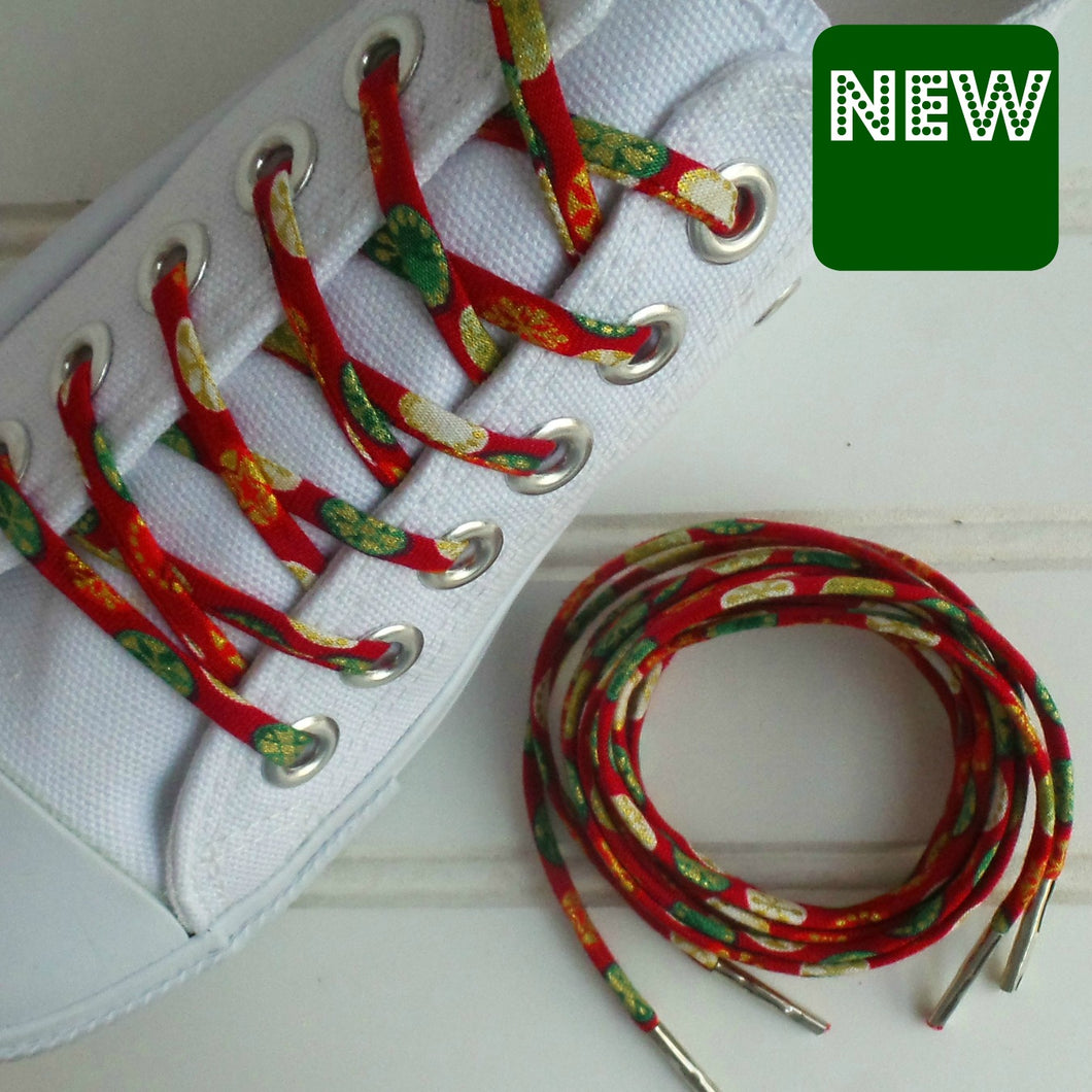 red green and gold shoelaces in white canvas shoes