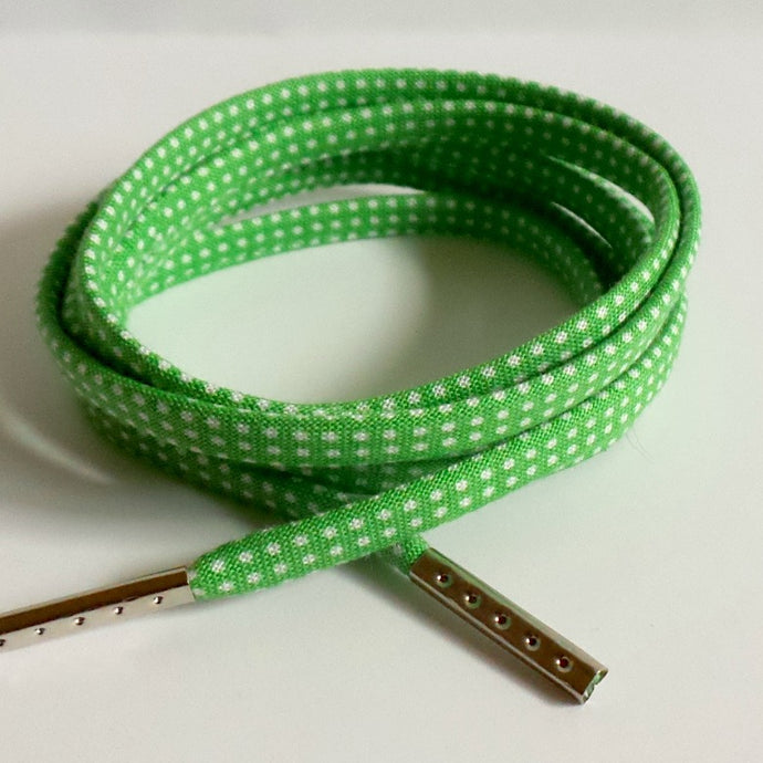 Shoelaces covered in Green Polka Dots