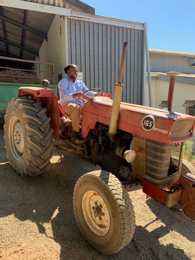 Alfonso Ali Wright, Founder of Brooklyn Tea, on a Tractor in South Africa