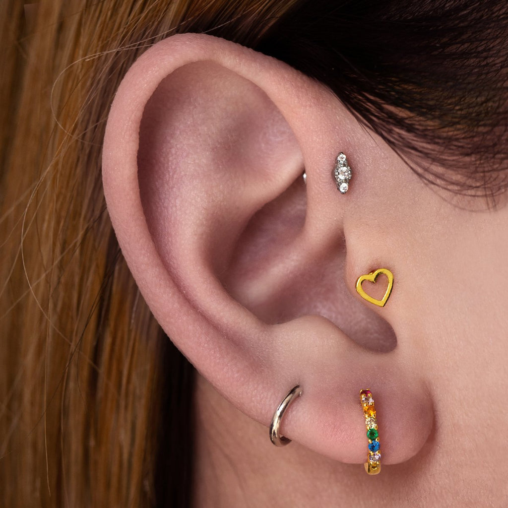 Hollow Heart Tragus Helix & Conch Piercing on model - gold