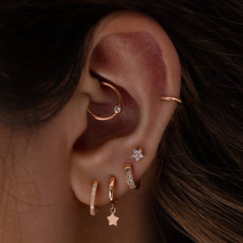 Solitaire Clicker Hoop Piercing on model - rose gold