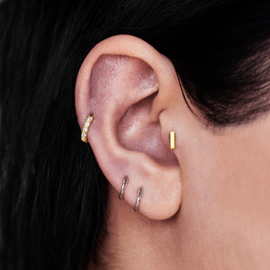 Bar Tragus Helix & Conch Piercing on model - 10kt solid gold