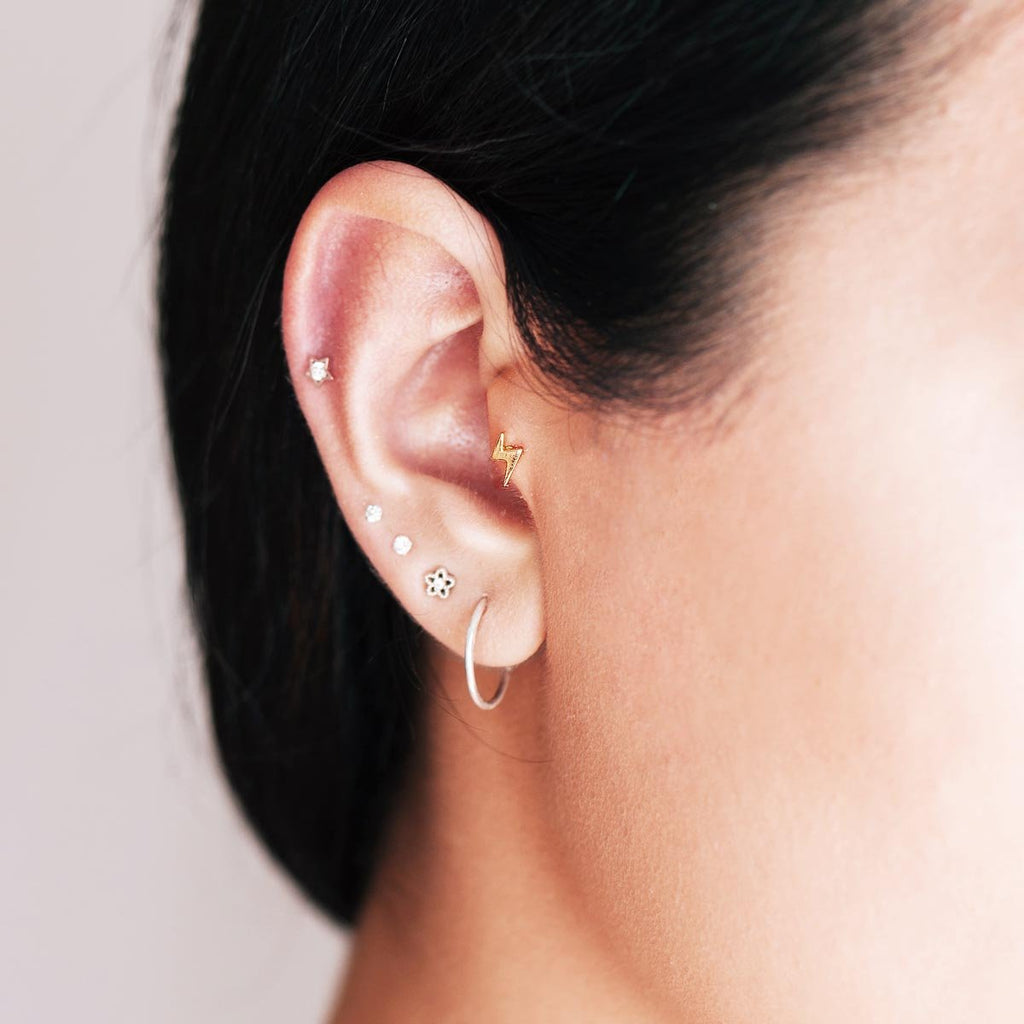 Lightning Bolt Tragus Helix & Conch Piercing on model - gold