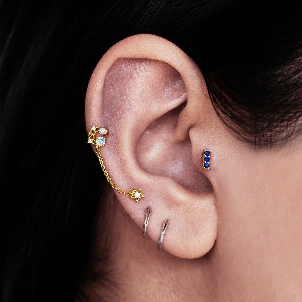 Celestial Moon & Star Chain Ear Piercing on model - gold