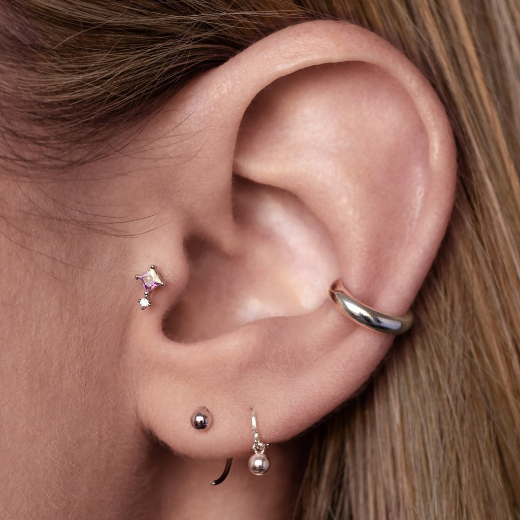 Chance Tragus Helix & Conch Piercing on model - silver