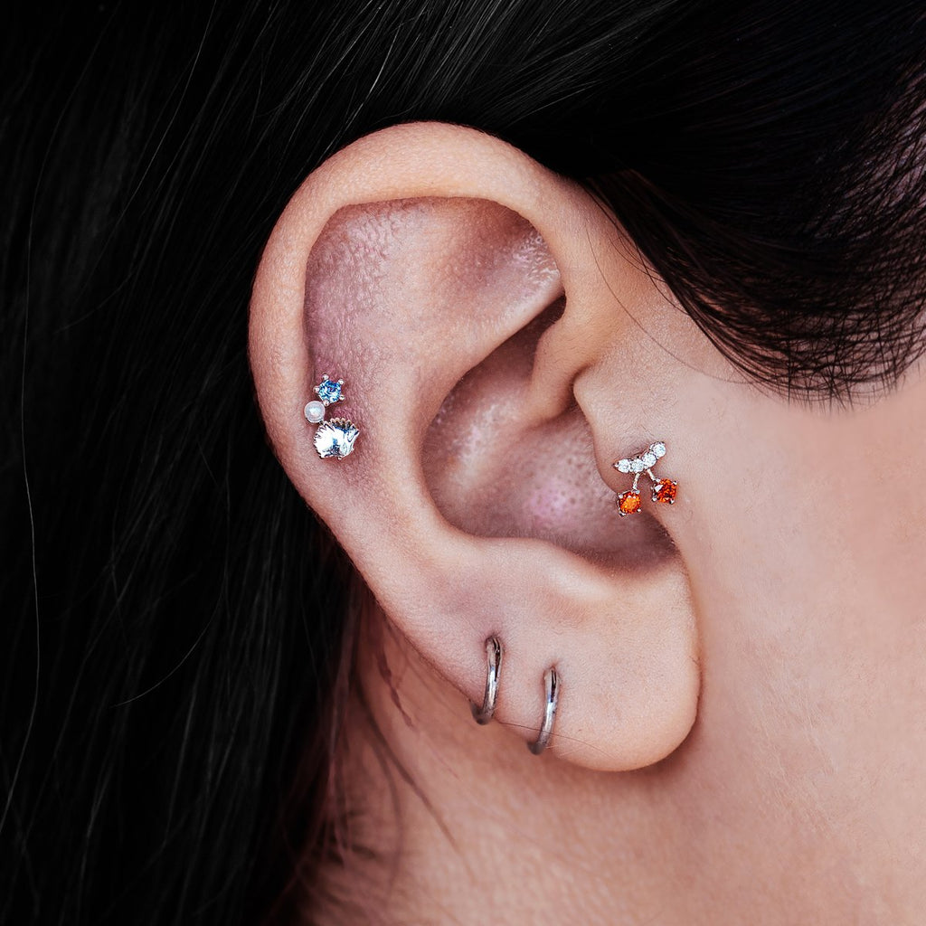 Cherry Tragus Helix & Conch Ear Piercing on model - silver