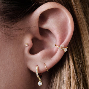 Clover Tragus Helix & Cartilage Ear Piercing on model - 10Kt solid gold
