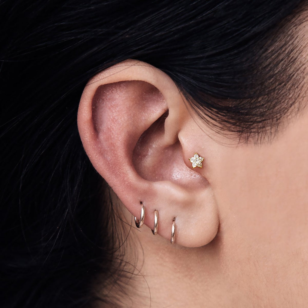 Crsytal Daisy Helix Conch & Tragus Piercing on model - 14kt gold