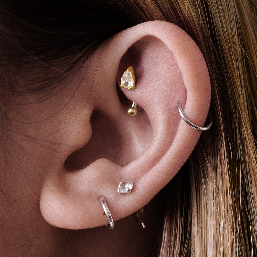 Elixir Daith & Rook Ear Piercing on model - gold