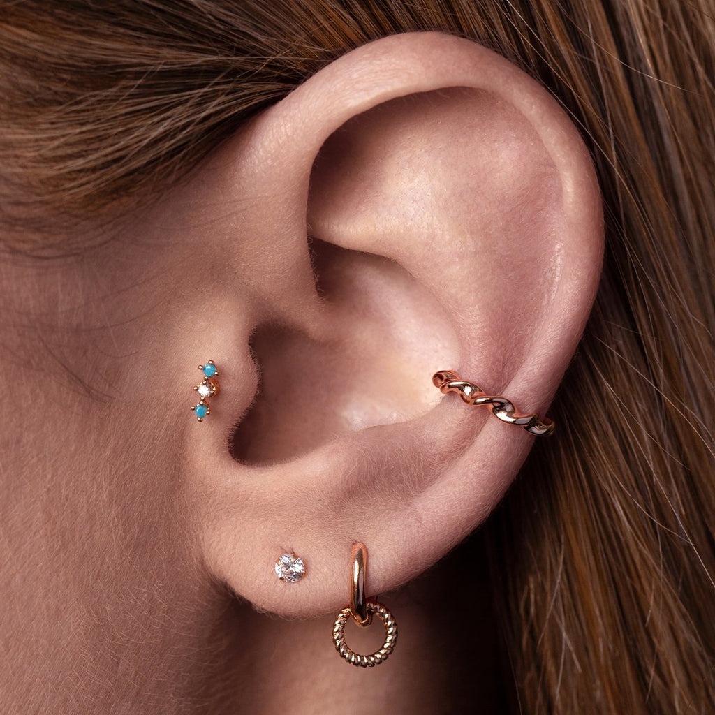 Gambit Tragus Helix & Conch Piercing on model - rose gold