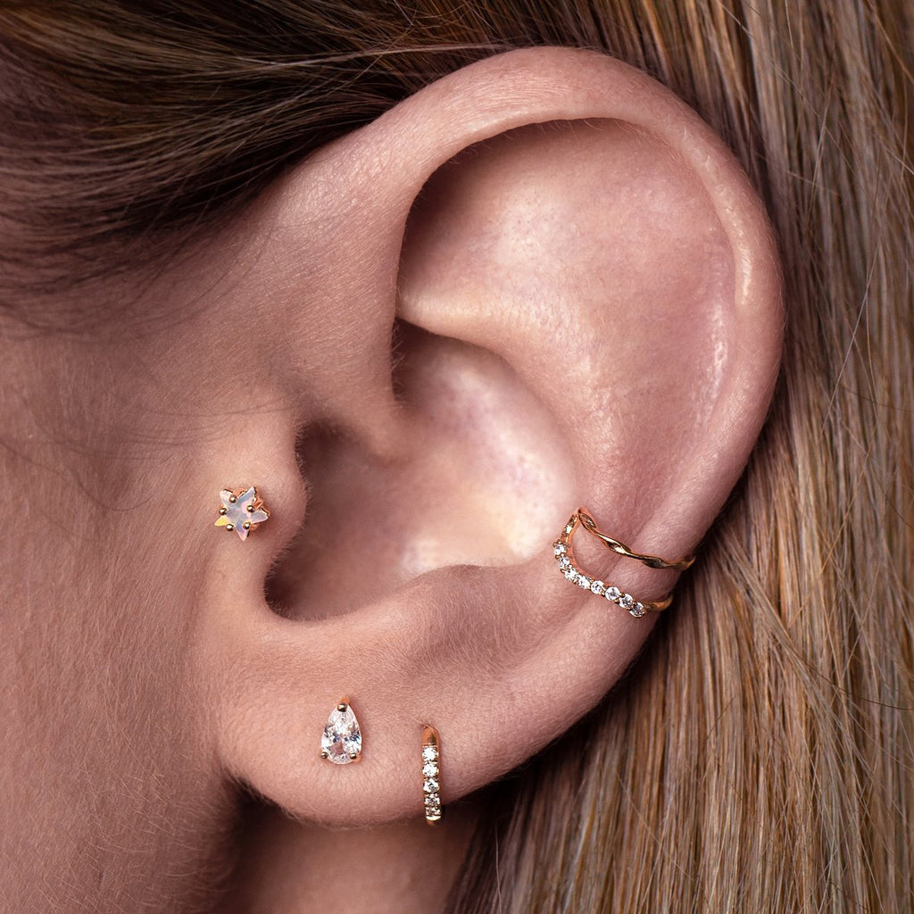 Halleys Opal Star Tragus Helix & Conch Piercing on model - rose gold