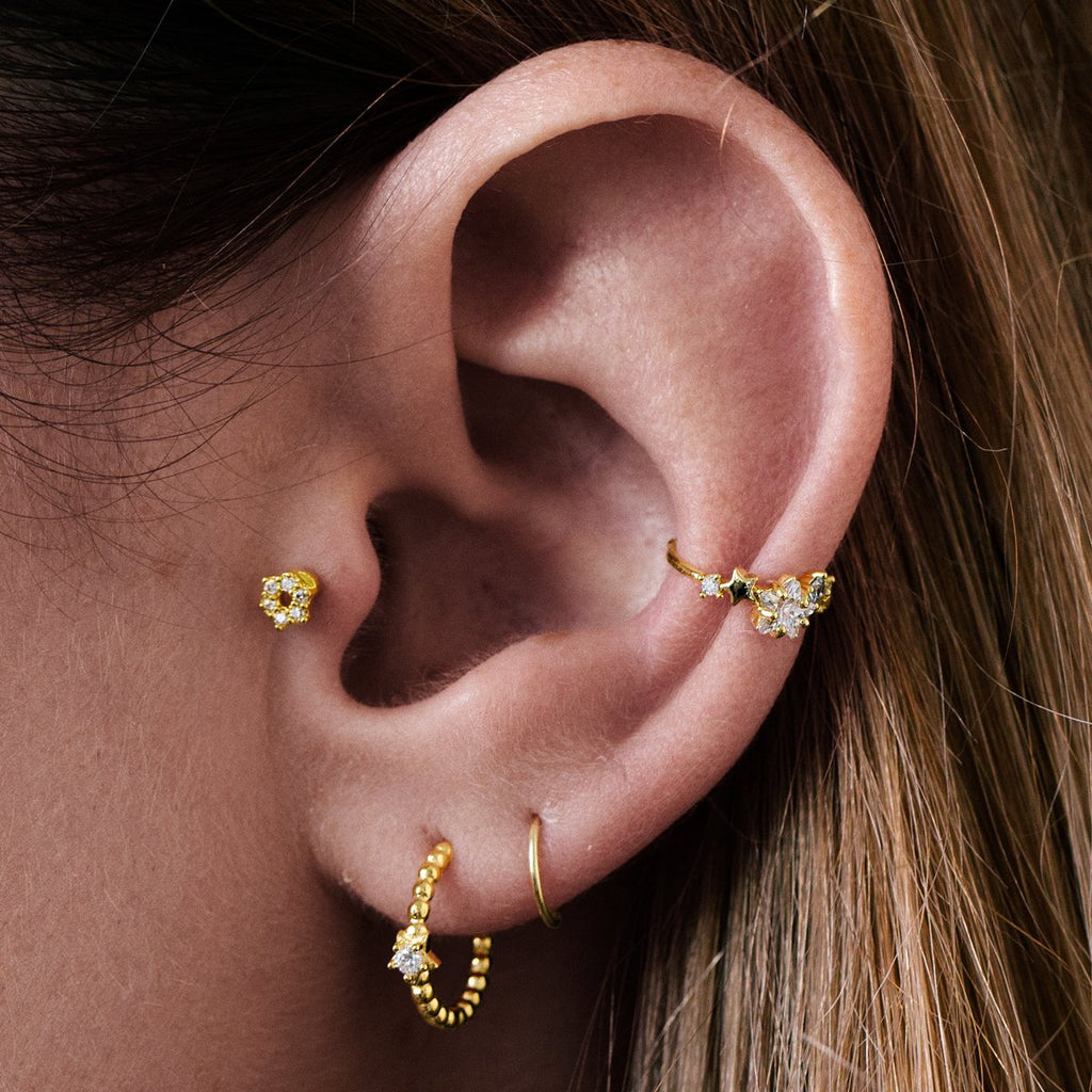 Hexagon Tragus Helix & Conch Ear Piercing on model - gold