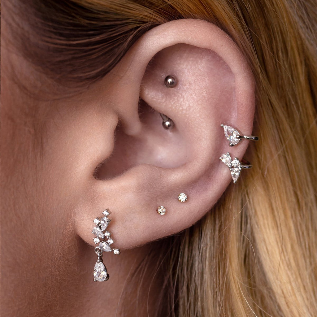Honesty Gem Tragus Helix & Conch Piercing on model - silver