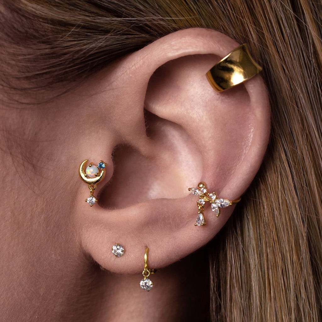 Luminary Moon Tragus Helix & Conch Piercing on model - gold