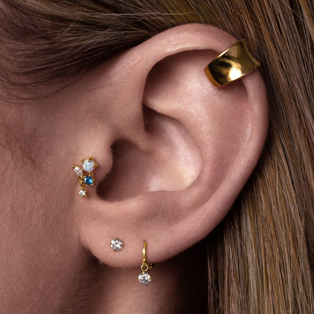 Milly Tragus Helix & Conch Piercing on model - gold