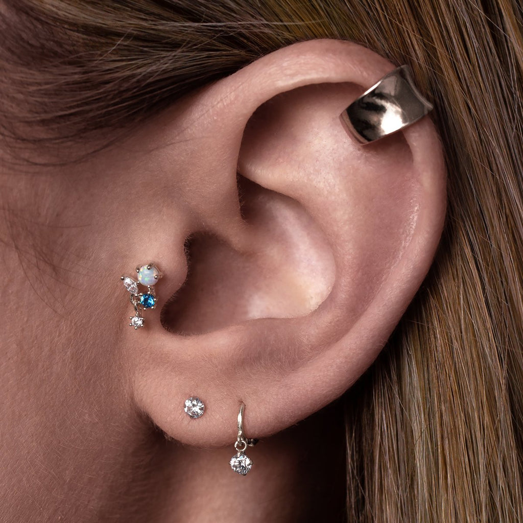 Milly Tragus Helix & Conch Piercing on model - silver