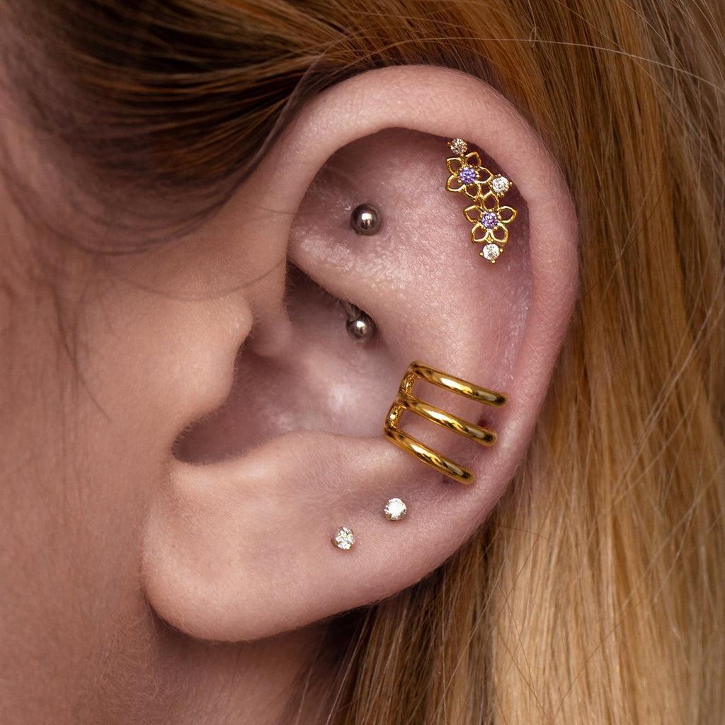 Monica Tragus Helix & Conch Piercing on model - gold