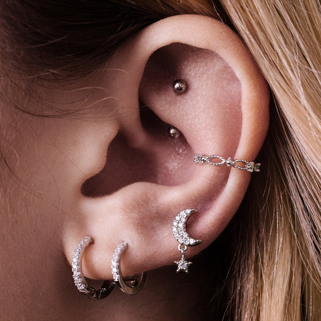 Moondrop Star Charm Tragus Helix & Conch Piercing on model - silver