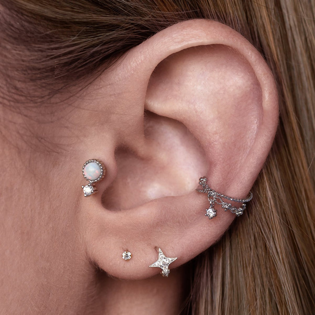 Neptune Opal Tragus Helix & Conch Piercing on model - silver