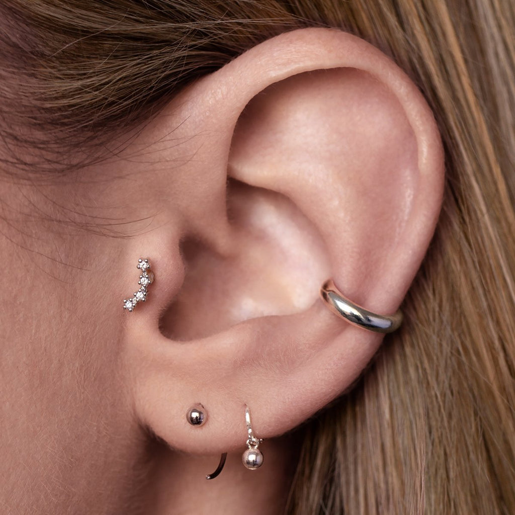 Nina Tragus Helix & Conch Piercing on model - silver