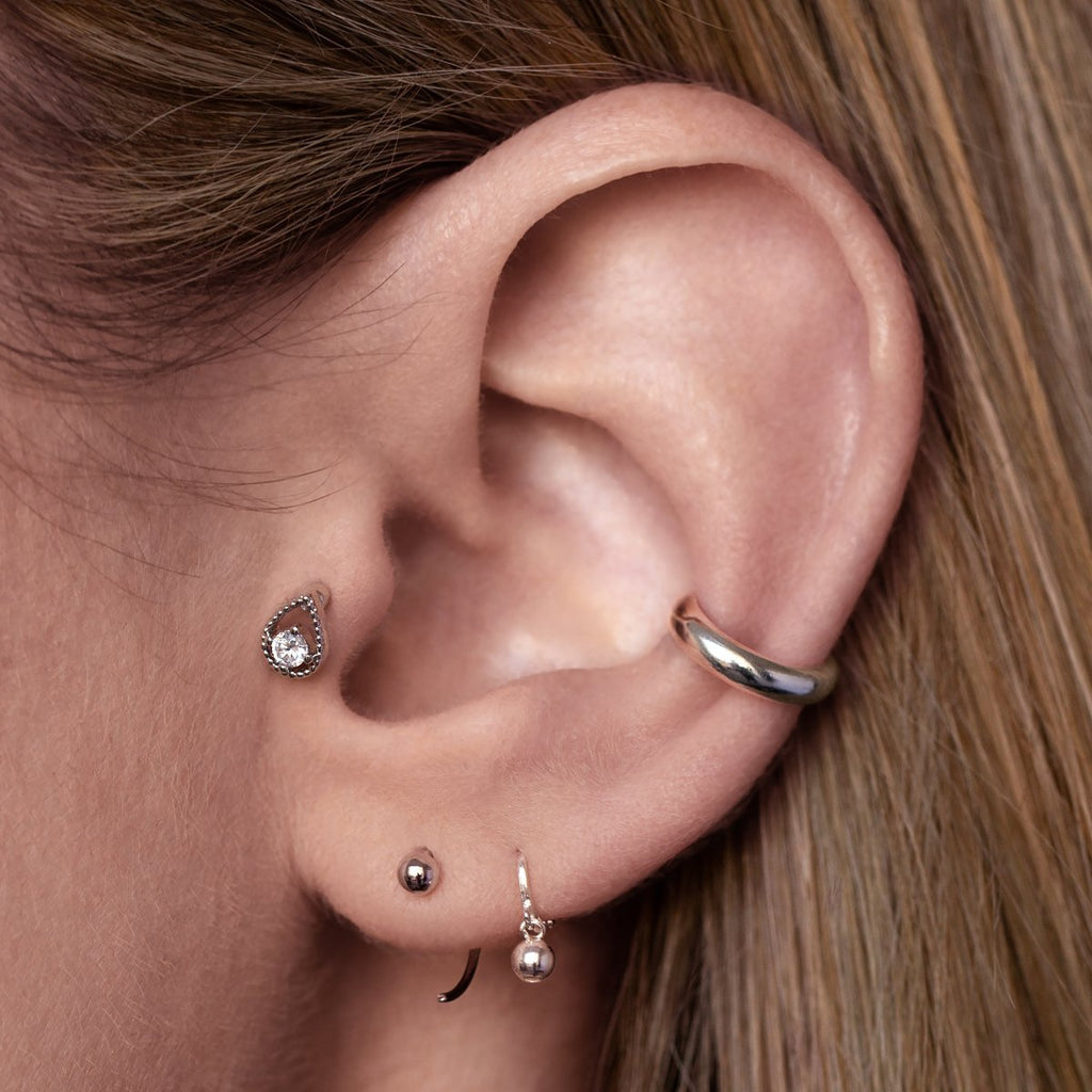 Notion Teardrop Tragus Helix & Conch Piercing on model - silver