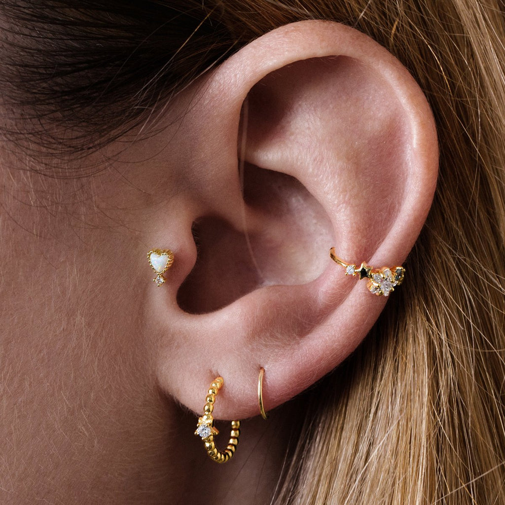 Opal Heart Tragus Helix & Conch Ear Piercing on model - gold
