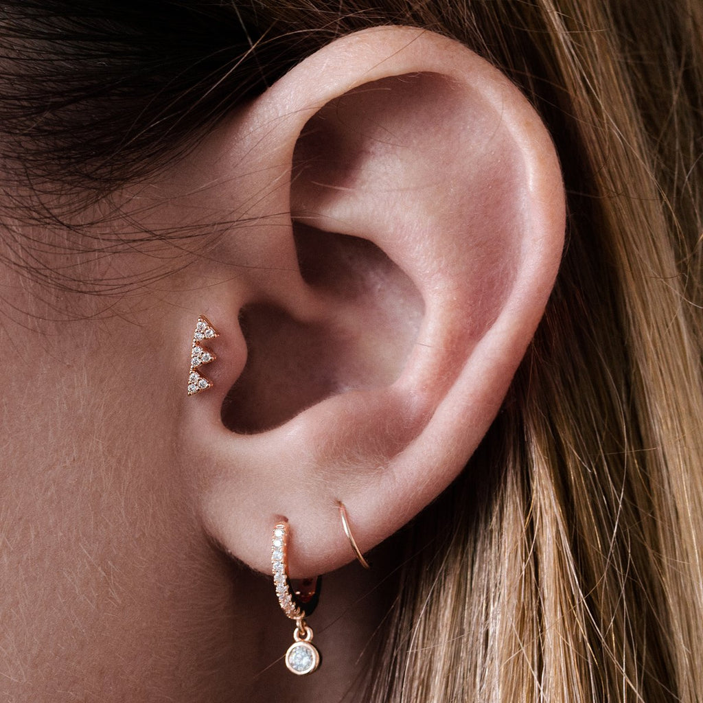 Prism Triangles Tragus Helix & Conch Ear Piercing on model - rose gold