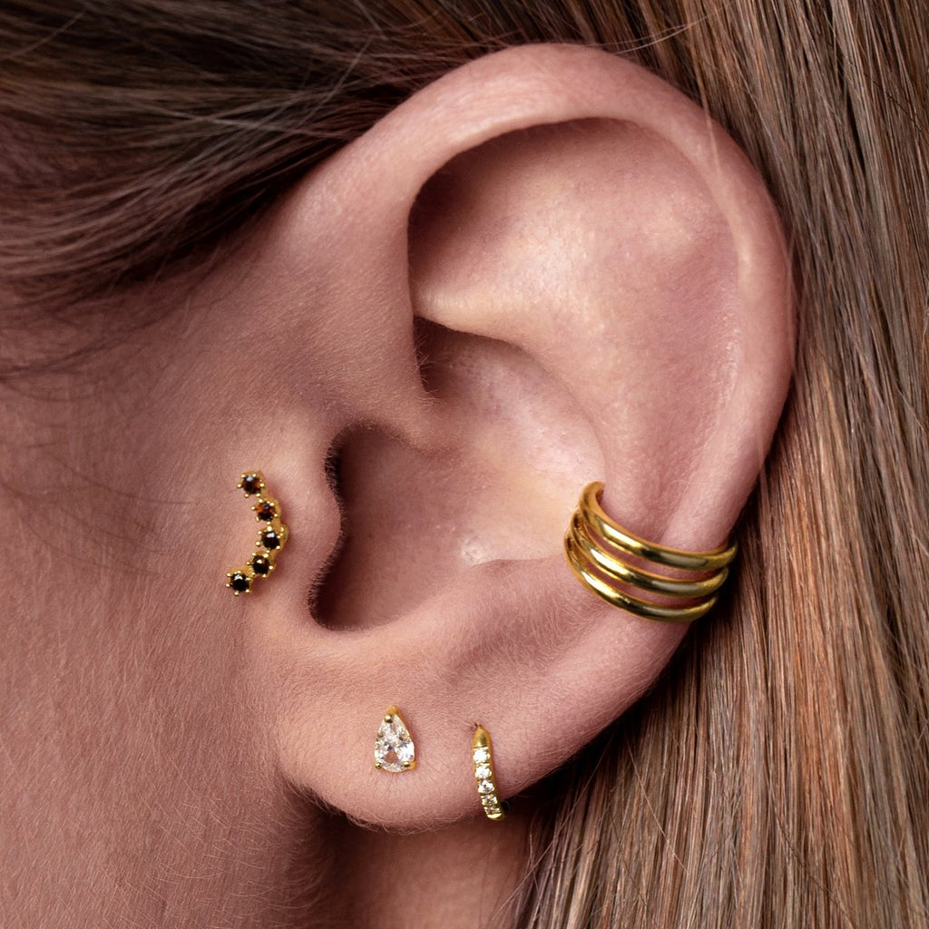 Ruby Array Tragus Helix & Conch Piercing on model - gold