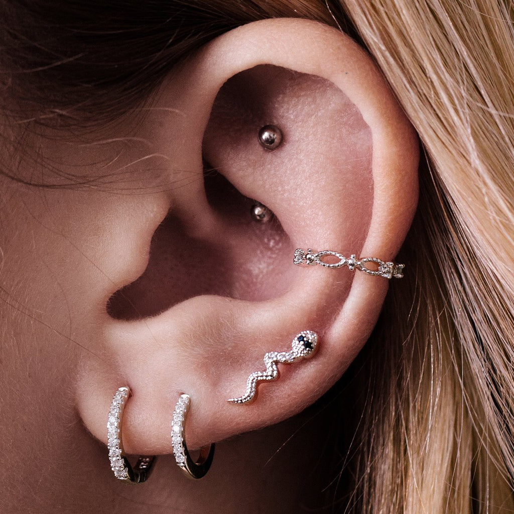 Serpent Tragus Helix & Conch Ear Piercing on model - silver