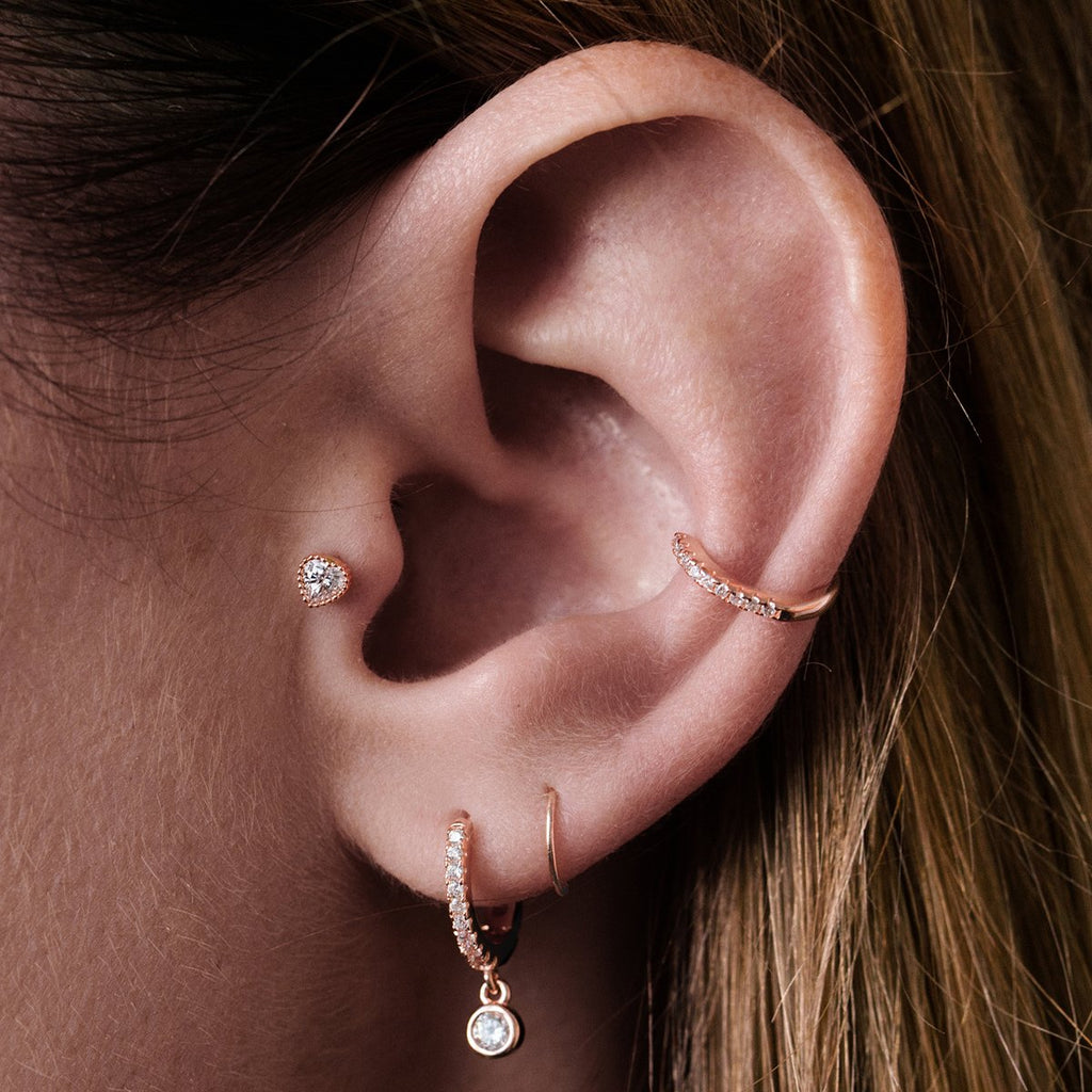 Solace Heart Tragus Helix & Conch Piercing on model - 10KT solid rose gold