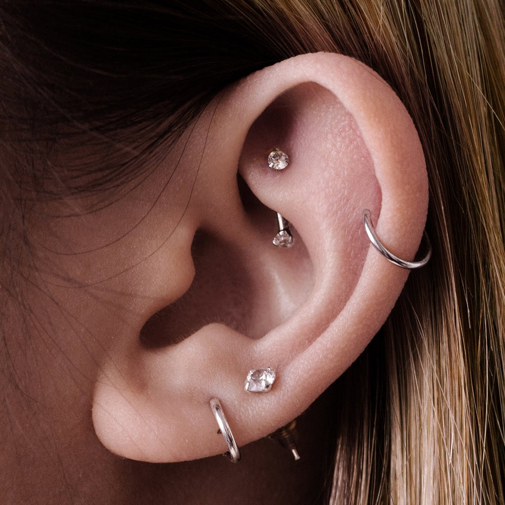 Twin Gem Daith & Rook Ear Piercing on model - crystal