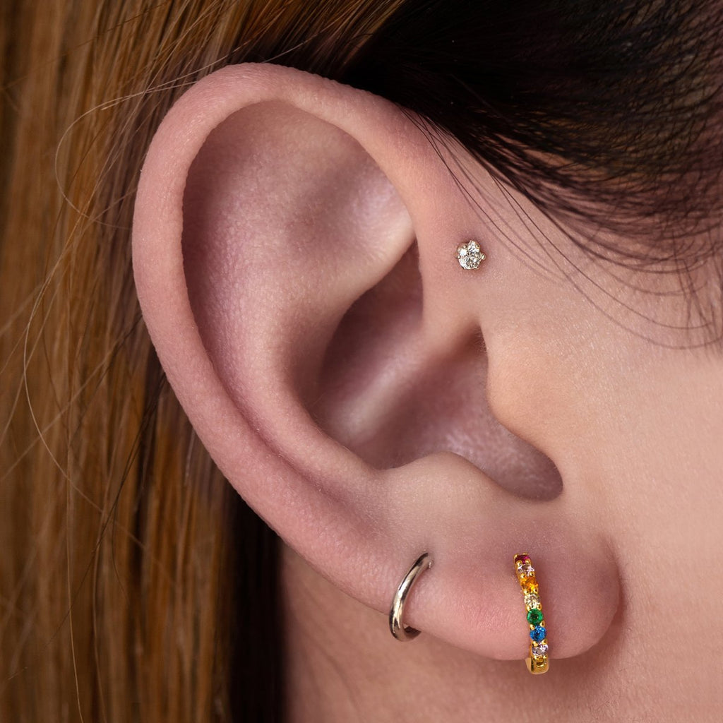 Solstice Gem Tragus Helix & Conch Piercing on model - silver