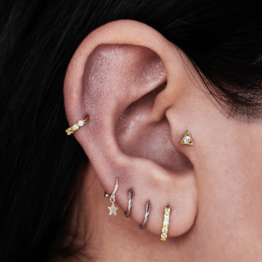 Temple Triangle Gem Tragus Helix & Conch Piercing on model - 10KT solid gold