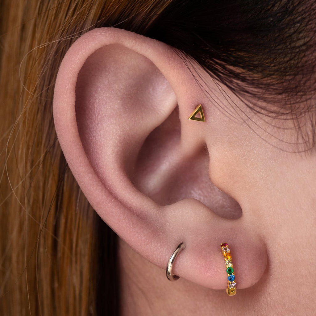 Hollow Triangle Tragus Helix & Conch Piercing on model - 14KT gold