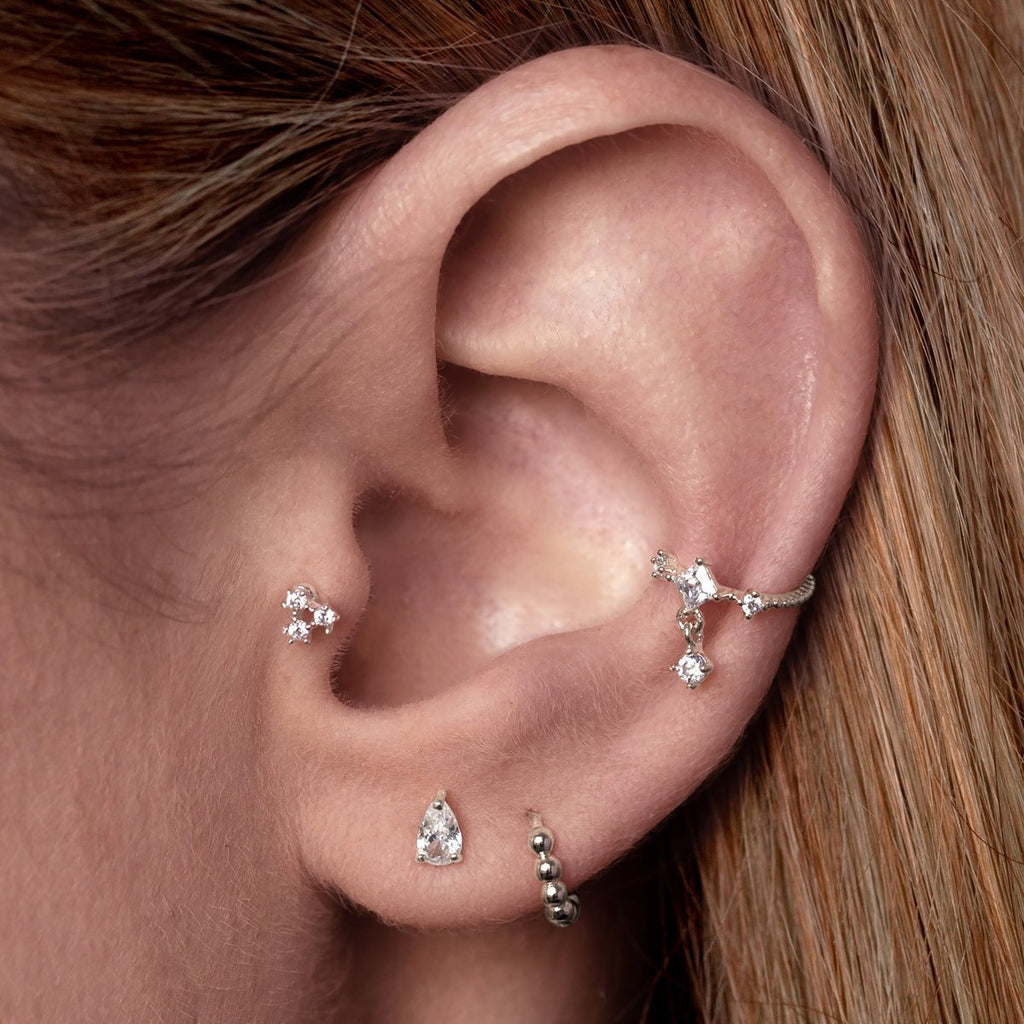 Triple Gem Tragus Helix & Conch Piercing on model - silver