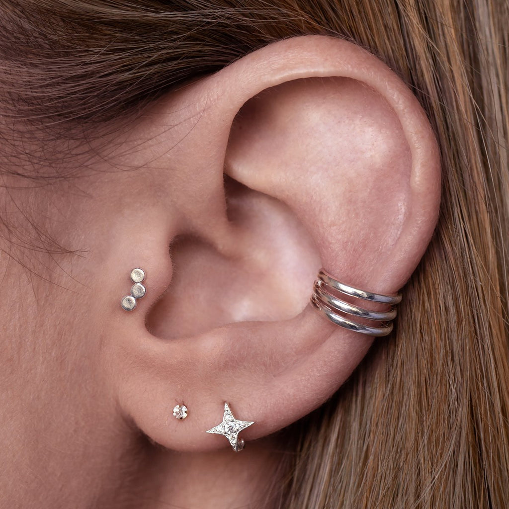 Triple Pendant Tragus Helix & Conch Piercing on model - sterling silver
