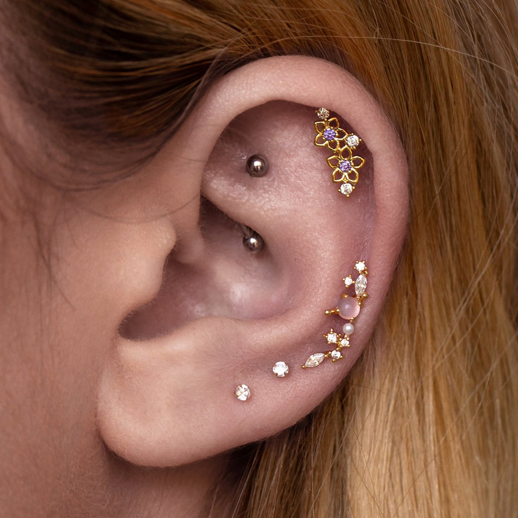 Riri Helix & Cartilage Ear Piercing on model 2 - gold