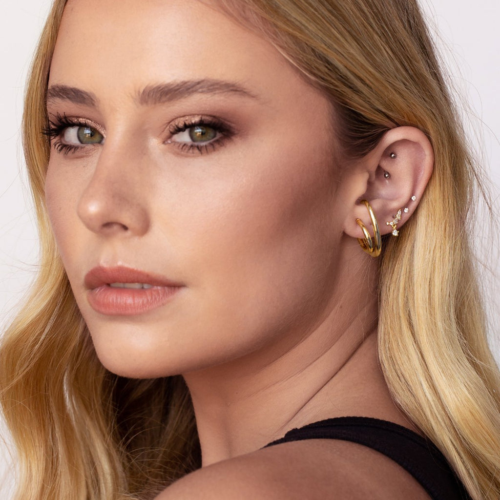 Glow Gemstone Stud Earrings on model 2 - gold
