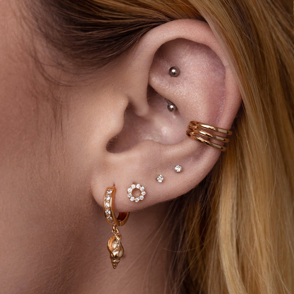 Shelby Seashell Huggie Earrings on model - rose gold