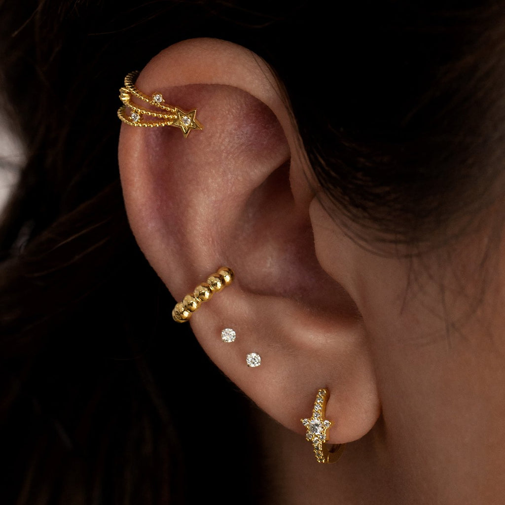 Starburst Huggie Hoop Earrings on model 2 - gold