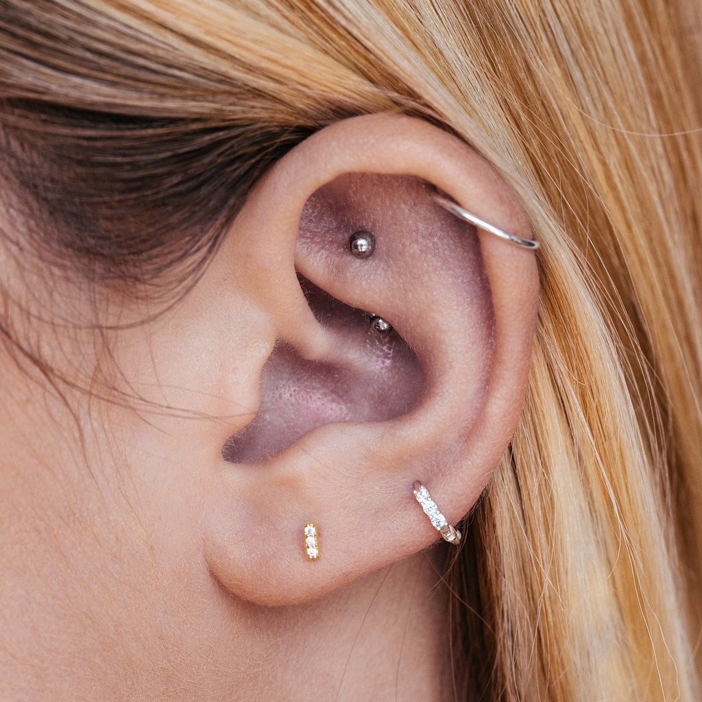 Absolute Stud Earrings on model - gold