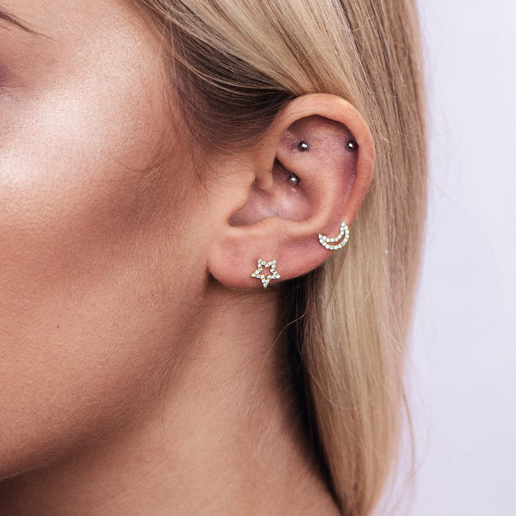 Before Midnight Star Moon Stud Earrings on model - gold