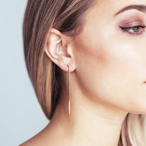 Chain earrings on model - rose gold