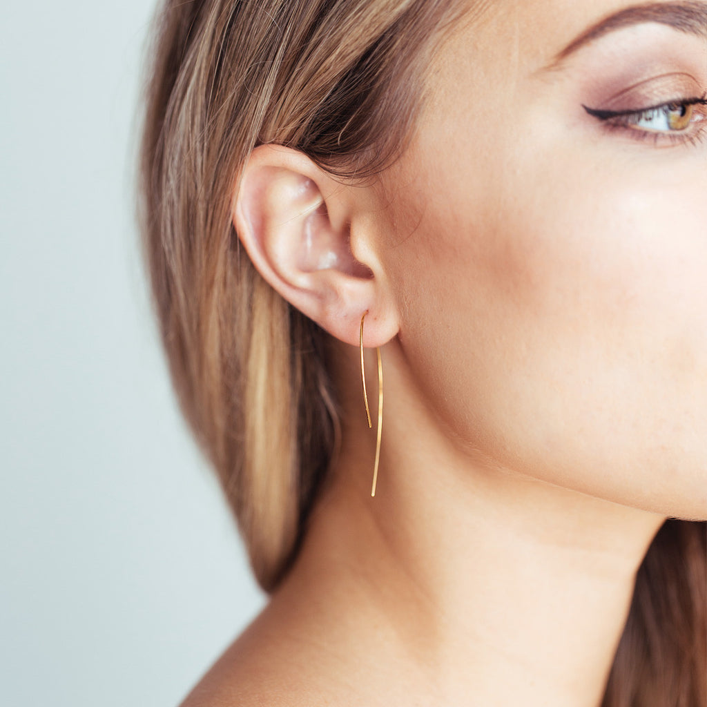 Lana minimalistic earrings on model 2 - gold