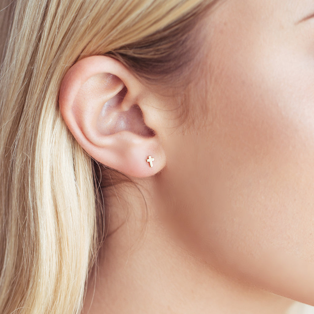 Mini Cross Stud Earrings on model - silver