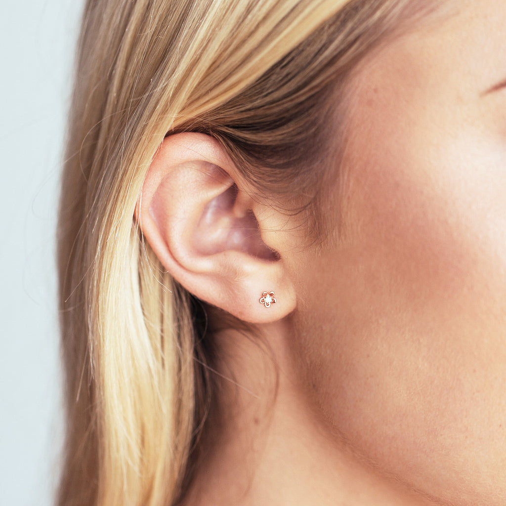 Mini Daisy Stud Earrings on model - rose gold