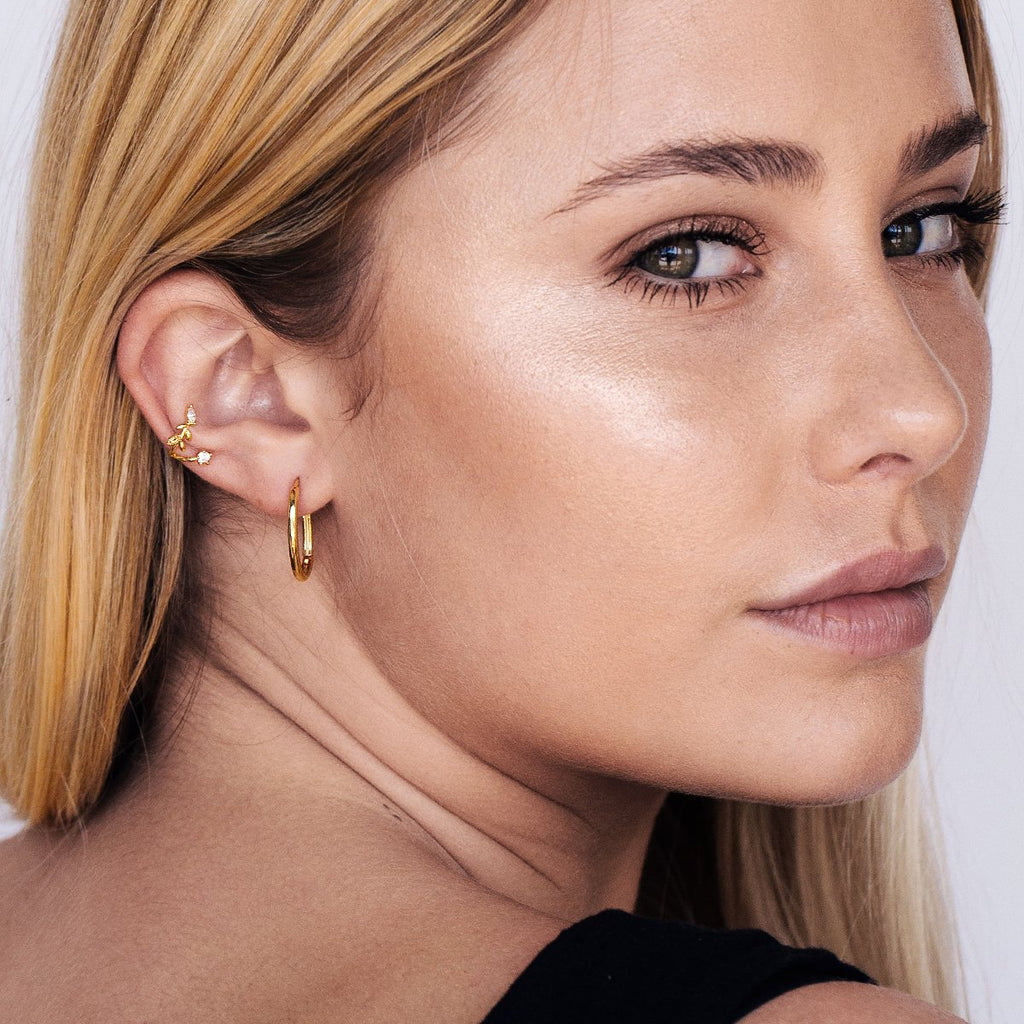 Olivia Oval Hoop Earrings on model - gold