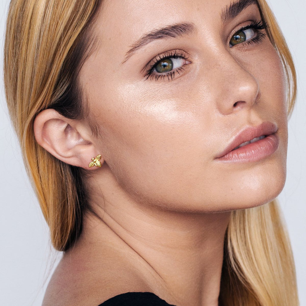 Queen B Stud Earrings on model 2 - gold