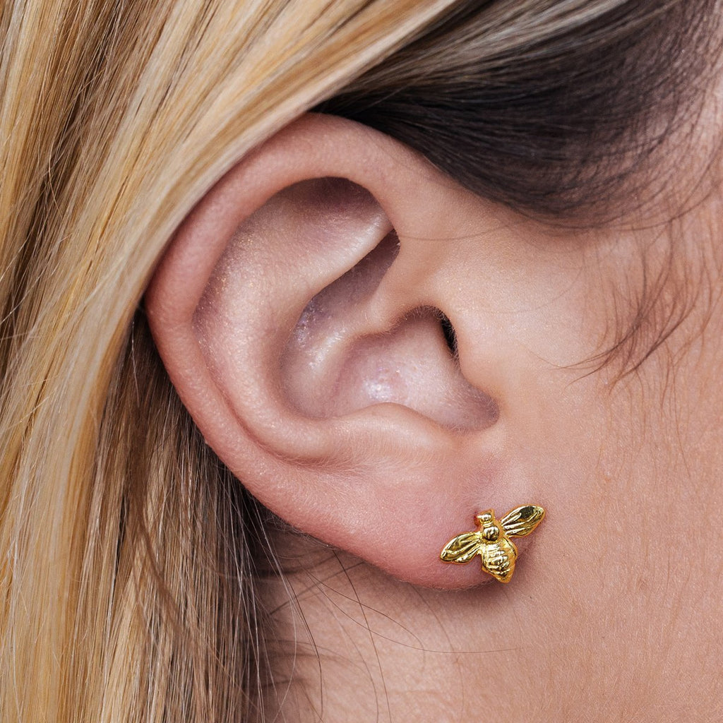 Queen B Stud Earrings on model - gold